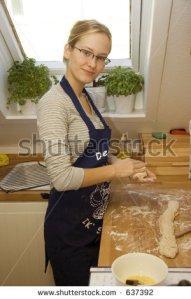 stock-photo-young-european-girl-baking-bread-637392